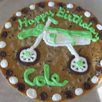 Dirtbike Cookie My nephew wanted a dirt bike cookie cake since he got a new dirt bike for his birthday. The dirt bike is green and white so I matched the...