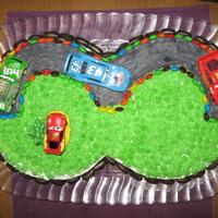 Cars #3 Track This was for a friend's son surprise 3rd birthday. He loves the movie Cars and found the idea here on CC. The cake is 2 9in rounds...