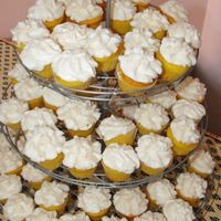 Mini Wedding Cupcakes   really cute cupcakes made to go with the cake that I posted earlier for a friends wedding.