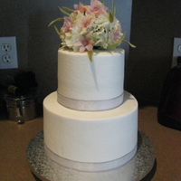 Simplicity buttercream w/ ribbon and flowers