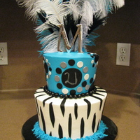 Feather   buttercream w/ fondant accents