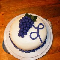 "Grape Birthday Cake Buttercream with fondant grapes and ""L""Made for my mom's bday (she collects grape things.) First try using fondant... it is..."