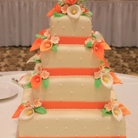 Orange Cali Lilly Wedding Orange and Ivory Cali Lillies square wedding cake Cali lillies out of gumpaste