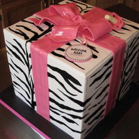 Wild Zebra Print Baby Shower Cake! Cake is covered in fondant. I hand painted the zebra stripes with black gel food coloring. Ribbon, bow, gift tag and pacifier are all...