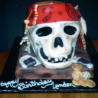 Skeleton 3D cake carved then covered in fondant. Airbrushed to make it look old.