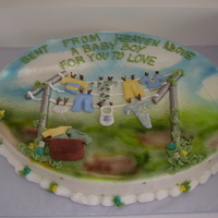 Clothes Line Pole This cake is easy to make for both a boy or girl. Just change color of clothes on the line. Butter cream covered then airbrushed. Clothes...