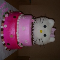 Hello Kitty Stacked cake covered in butter cream and airbrushed. Kitty head made out of rice krispy