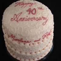 40Th Anniversary This is my parents 40th wedding anniversary cake. What appears to be a curly decorated cake at first glance is really the kids names on the...