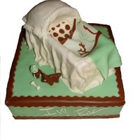 Bassinet Cake This is my sisters baby shower cake. The crib blanket is actually her crib set for the nursery.
