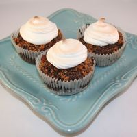 S'more Cupcakes Chocolate cupcake with crushed graham crackers and chopped chocolate, with a marshmallow topping ( put under the broiler for a minute to...