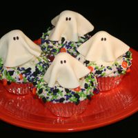Ghost Cupcakes Scratch vanilla cupcakes with vanilla BC, Marshmallow fondant ghost ( shaped around a large marshmallow - cut in 1/2 the long way) and...