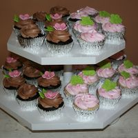 Birthday Cupcakes Chocolate fudge cupcakes with choc BC and vanilla cupcakes with strawberry BC...with fondant accents