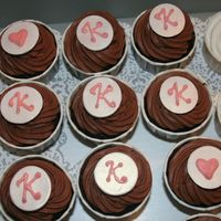 Chocolate Overload Cupcakes chocolate cupcake with white chocolate ganache filling and rich chocolate icing - fondant disc with pink colored chocolate initial on top
