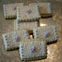 Cookies_For_Katie.jpg Sugar cookies with fondant, brushed with luster dust and RI flower and dots added.