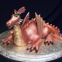 Oh! You're A Girl Dragon! This cake was made for a wonderful soldier and his wife for their first year wedding anniversary. He absolutely loves dragons! The body and...