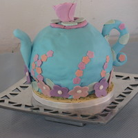 Teapot 1st time covering a ball in fondant. This cake was a learning experience. I don't love the spout, but my family loved it. For my mom&#...