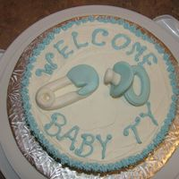 Baby Ty Vanilla cake with Buttercream icing and fondant soother and diaper pin.a quick cake i did up for a friend of a friend and her new baby boy...