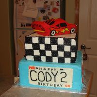 2 Nd Bday 2 layer cake , vanilla with Pina colada filling and chocolate with butterscotch filling . Car on top is carved from cake ( loaf pan) All...