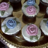 Practicing Roses Just learned how to do roses, lol. Chocolate fudge cupcakes with buttercream! Yummy!