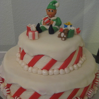 "Candy Cane/elf Christmas This was made for a ""Christmas in October"" fundraiser for a little girl in my community with cancer. Top layer: white cake with..."