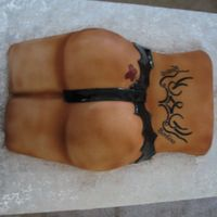Apple Bottom - Tramp Stamp Fondant covered 'Apple Bottom' I made this for a lady giving her guy a strip club party, of course he didn't know what he...