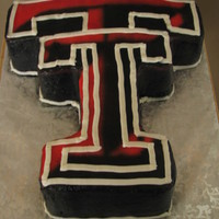Texas Tech Logo Yellow cake, buttercream iced and airbrushed colors.
