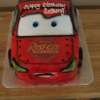 Lightning Mcqueen Yellow cake, sculpted and filled with buttercream, covered in fondant.
