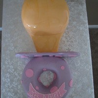 Baby Pacifier Pacifier Cake, covered in fondant. Strawberry cake and yellow cake with bc icing.