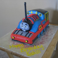 Thomas The Tank Engine Thomas, covered in fondant accents. My kids told me that he looks kind of scary, lol! I hope the birthday boy doesn't get scared of...