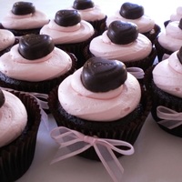 Happy Valentine's Day Cupcakes! Chocolate Cupcakes with ganache filling, buttercream icing and a DOVE chocolate heart.
