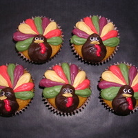 Gobble Gobble! Pumpkin Cupcakes with buttercream turkeys.