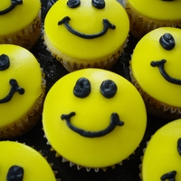 "Smiley Face Cupcakes I made these for my son's class on his half birthday since his birthday is in the summer. I asked him what he wanted. He said, ""..."