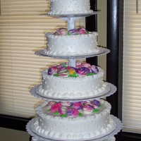 1St Wedding Cake Wasc & chocolate layers with buttercream icing.Flowers are buttercream &are air brushed- tye-died purple,pink,yellow, green&...