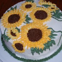 Another Sunflower Cake this one done in bc - for my OTHER g-ma -- lol. doctored butter pecan mix with bc frosting and decorations. Still need to work on my...