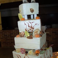 Fall Wedding Cake white chocolate leaves, marzipan pumpkins and carmel acorns.
