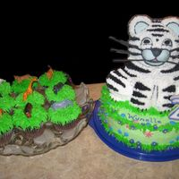 3-D Tiger Cake With Zoo Animal Cupcakes
