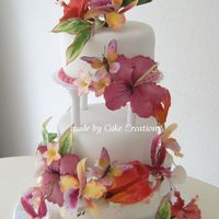 Tropical Wedding Cake Bride wanted a tropical wedding cake with a Bird of Paradise on top. Lemon cake, filled with cherry cream, raspberries and pinapple...