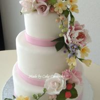 Strawberries And Summer! Almond cake with cherry filling and iced in chocolate ganache and fondant. All flowers are gumpaste. Bride wanted a summer wedding cake...