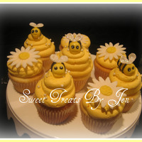 Baby Bumble Bee Cupcakes Bees made out of fondant.