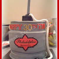 Keg Cake Philadelphia Brewing company 30th Birthday Keg Cake, 5 layers of round cake, tap is made of rice krispies and a straw. Logo was printed.