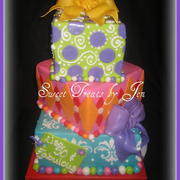 "Stacked Gift Boxes   Stacked square boxes. 6"", 8"" and 10"". Decorated in fondant."