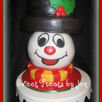 Frosty The Snowman   3d frosty, 2 tiered with sport ball. Covered in fondant