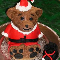 Teddy Clause this is a build a bear pan with fondant for clothes and instead of toys in his bag there is mimi marshmellows