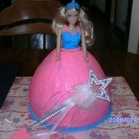 Princess Doll Cake   Made this for my granddaughter's 4th birthday to go with her castle cake. Cake was made with the wonder mold and an 8 inch round.