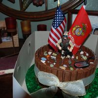 Marines Birthday Cake I made this yellow cake with Chocolate icing and KitKats around the whole cake as a border.