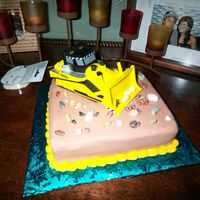 Heavy Equipment Cake I made this Heavy equipment cake for my daughter's father's birthday. 4-25-09