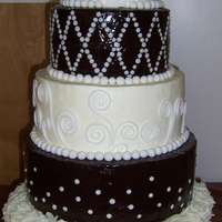Chocolate Wedding Cake this cake was actually made for a church chocolate event, that wanted a wedding cake focal point. But in Chocolate. Sooo, chocolate cake...