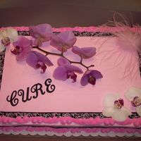 American Cancer Society/birthday Cake  a friend gave up her 15th b-day party to raise money for cancer research, so i did a 1/2 cancer 1/2 birthday cake for her. Real orchids,...