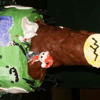 This Is Halloween  this cake was done for my sons 3rd b-day, figures are made out of gumpaste and chocolate mmf(tree), fencing is made out of royal icing, i...