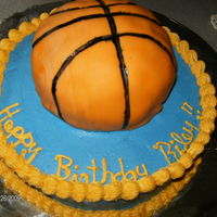 Basket Ball Cake   chocolate cake covered in buttercream, basket ball done in fondant..